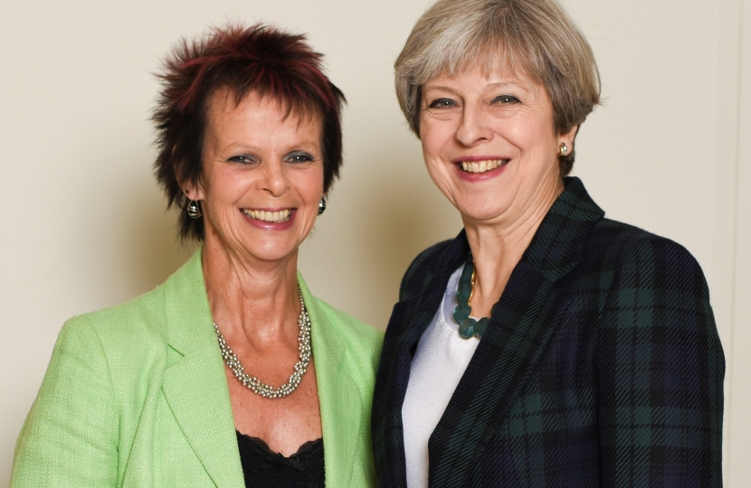 Anne Milton and Theresa May